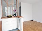 APRÈS: cuisine, entrée, couloir et séjour décloisonnés