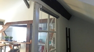 AVANT : porte coulissante vitrée entre la micro-chambre parentale et le séjour