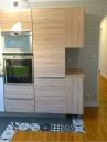 APRES : des matériaux plus chaleureux, un style plus contemporain et une cuisine en lien direct avec l'entrée
